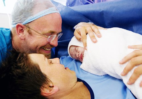 Cesarean Birth with Parents Holding Baby