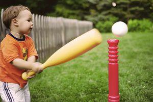 preschooler playing T-ball