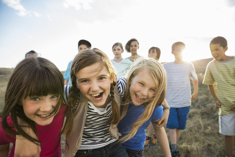 Group portrait of kids having fun outdoors