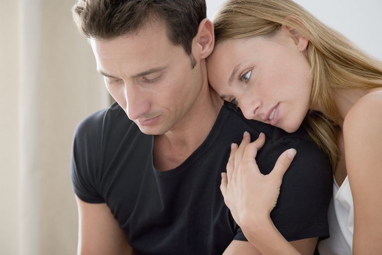 Couple comforting each other through infertility, having decided against going through IVF