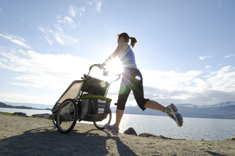 Woman running outside with jogging stroller