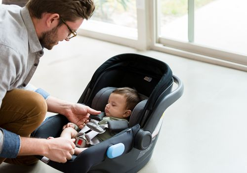 dad with newborn car seat
