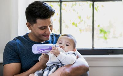 bipoc-man-babysitting-baby