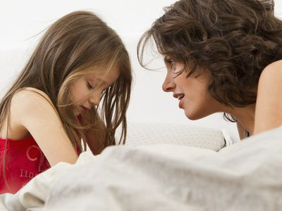 mom and girl talking