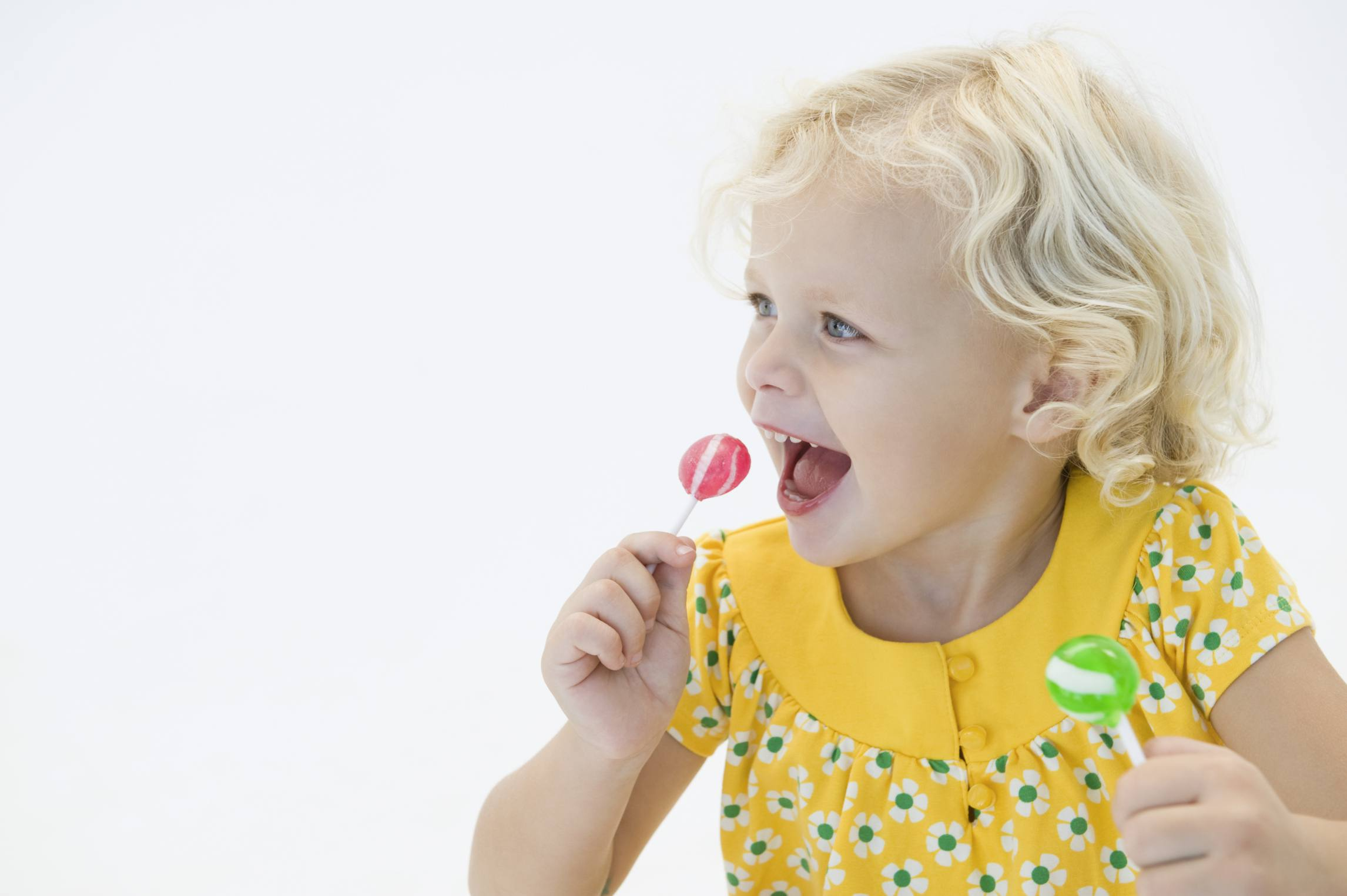 Child with two lollypops