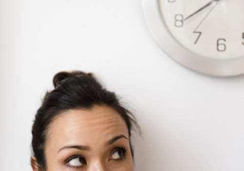 woman eyeing the clock