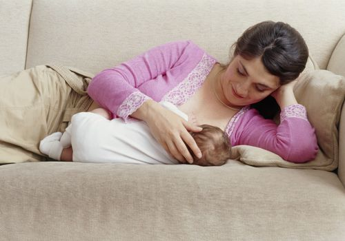 Mom and baby doing side-lying breastfeeding