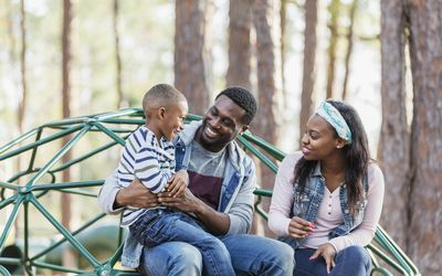 African-American family with boy on playground