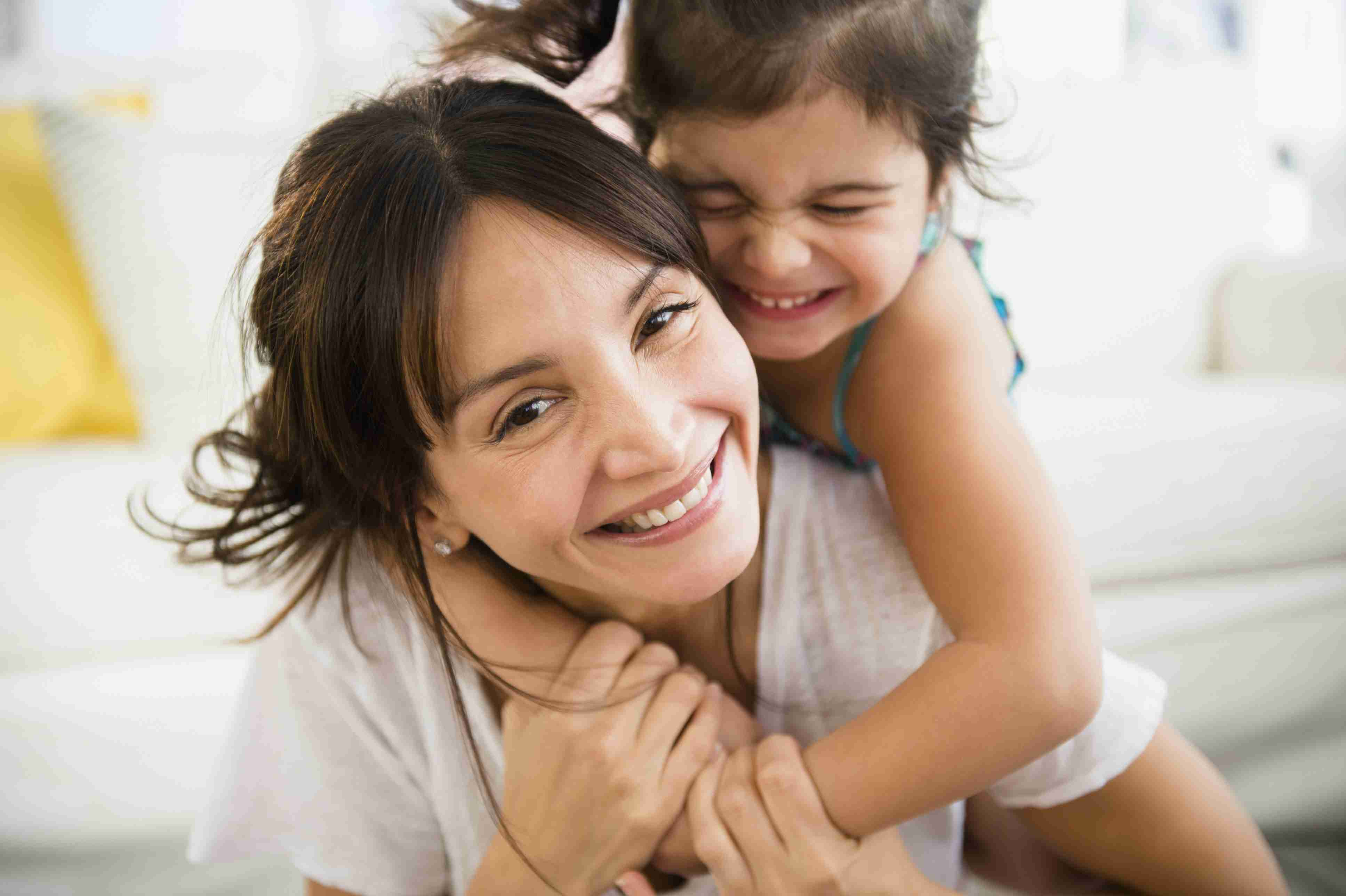 mother daughter hugging, cuddling