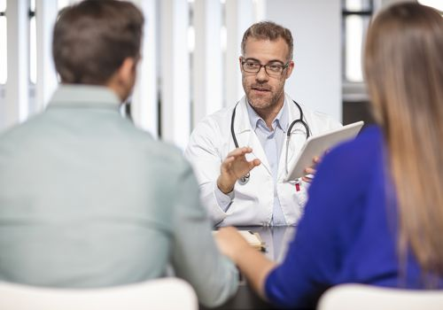 Doctor talking to a couple