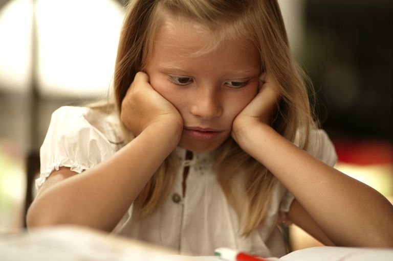 learning disability - girl sad with book