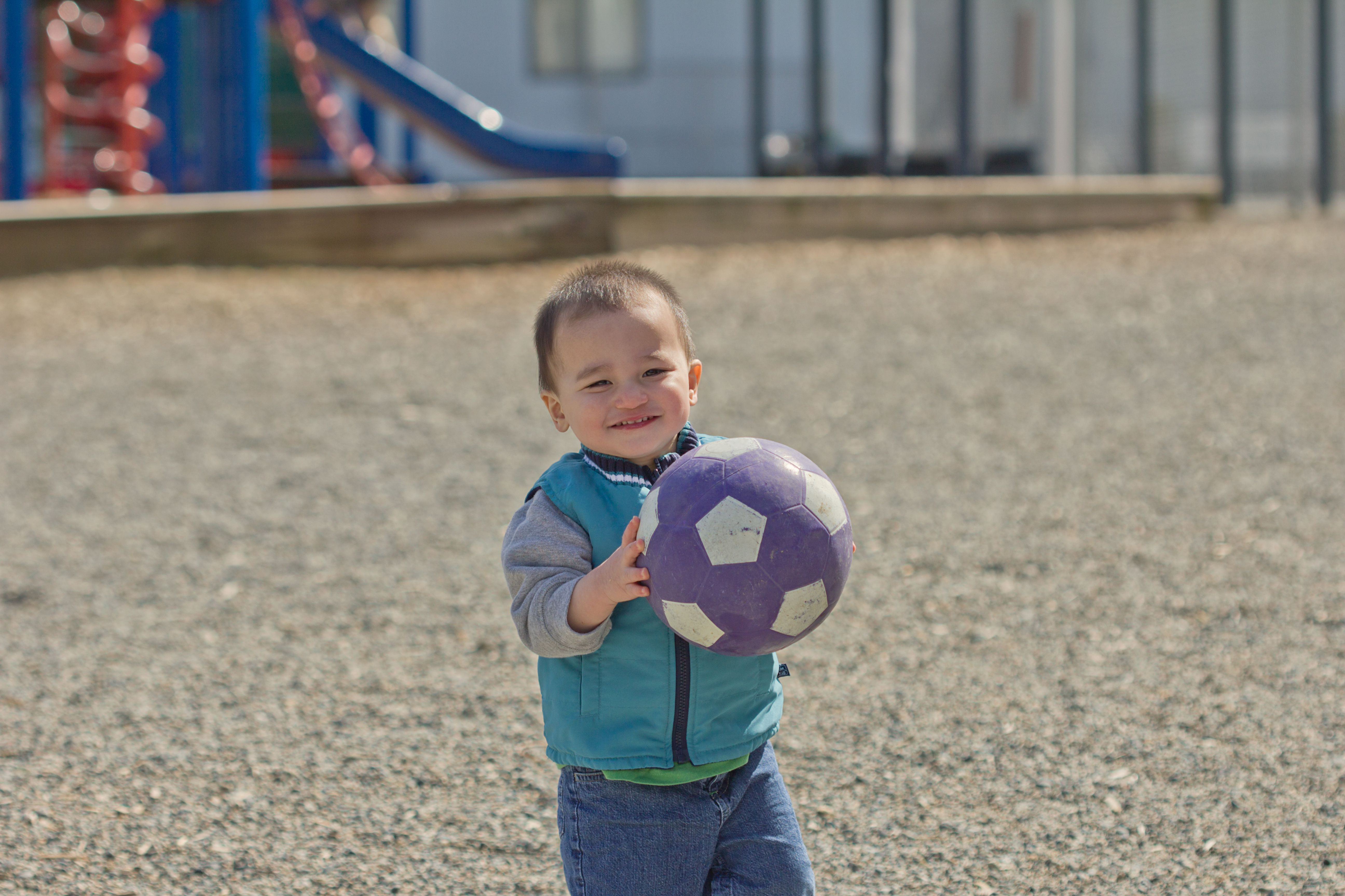 a toddler holding a soccer ball