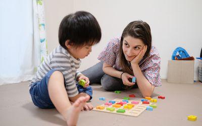 Toddler playing with alphabet blocks