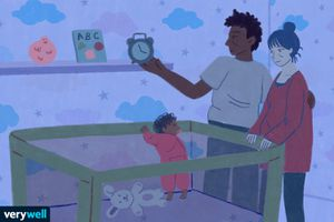 illustration of parents standing over baby's crib, dad is holding a clock