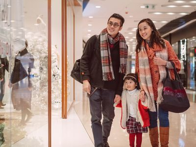 couple with daughter Christmas shopping at the mall