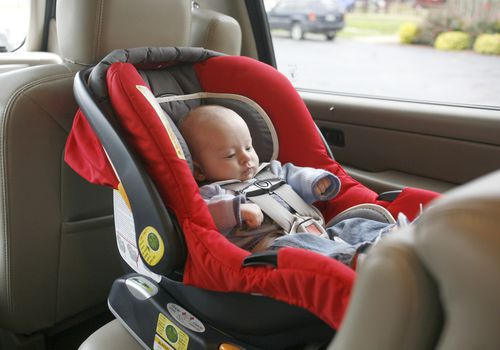 Infant in rear-facing car seat