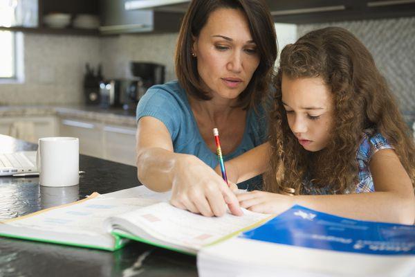 Homeschool parent helping daughter with her studies