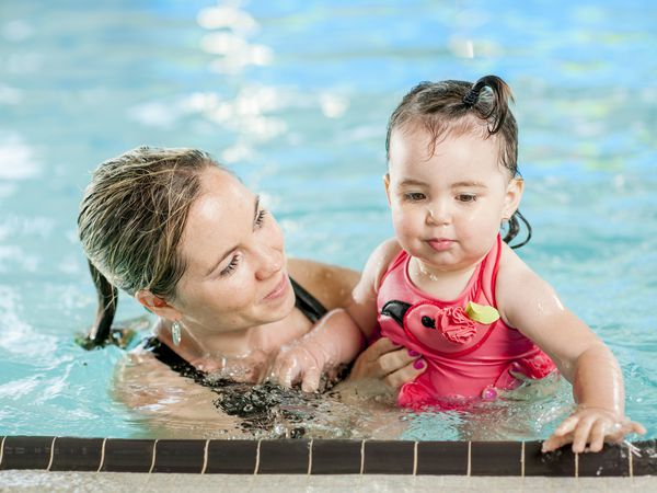 Woman and toddler swimming.