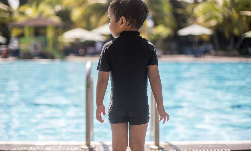 child at pool