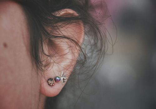 Cropped Image Of Person With Earrings