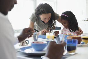 Family talking at breakfast table