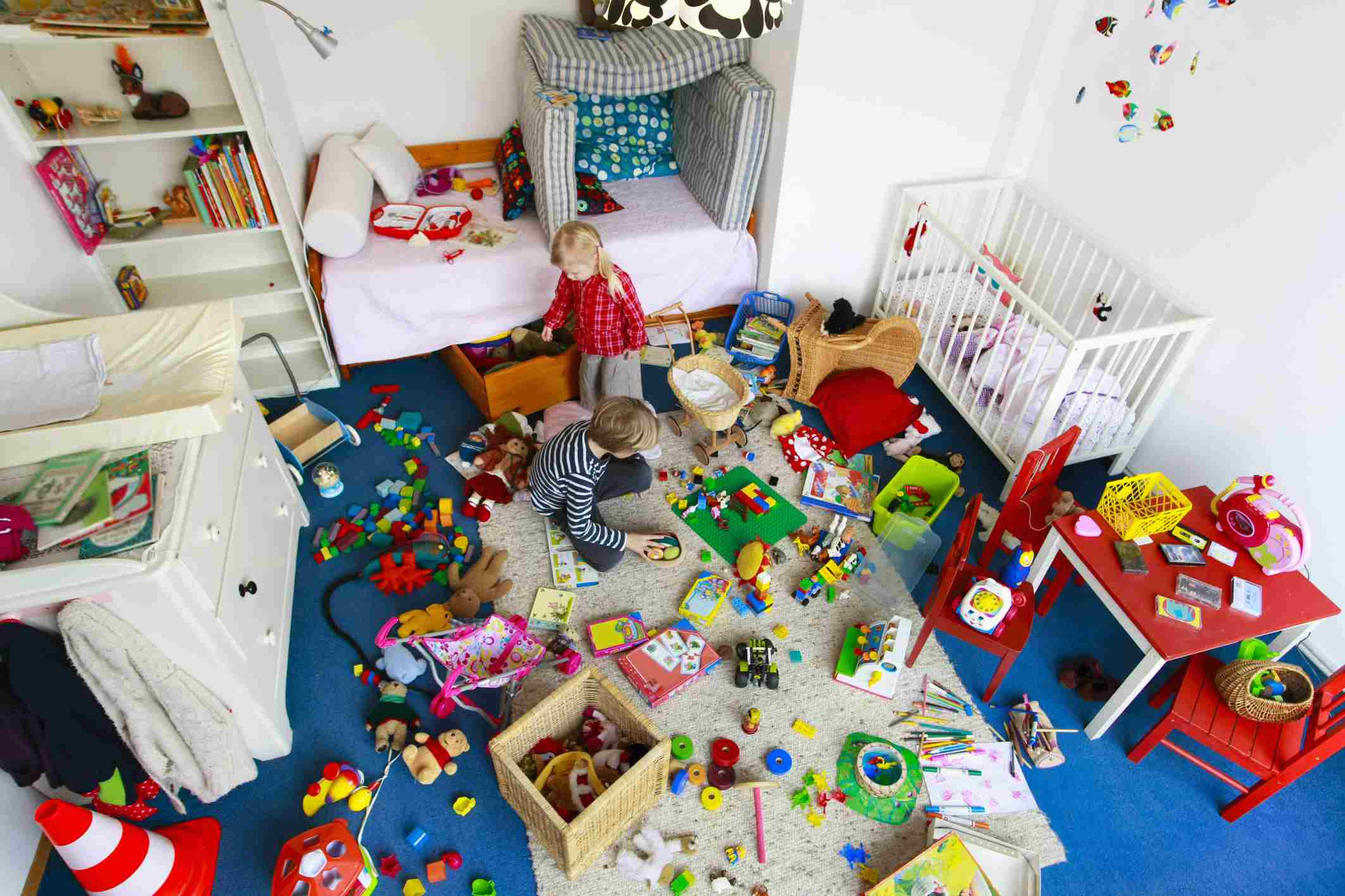 children in a messy room