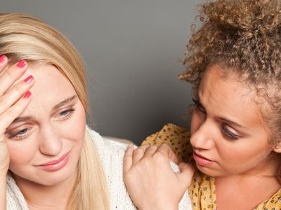 A woman comforts her sad friend