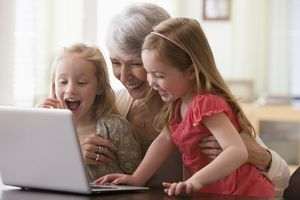 grandmother and granddaughters doing online shopping