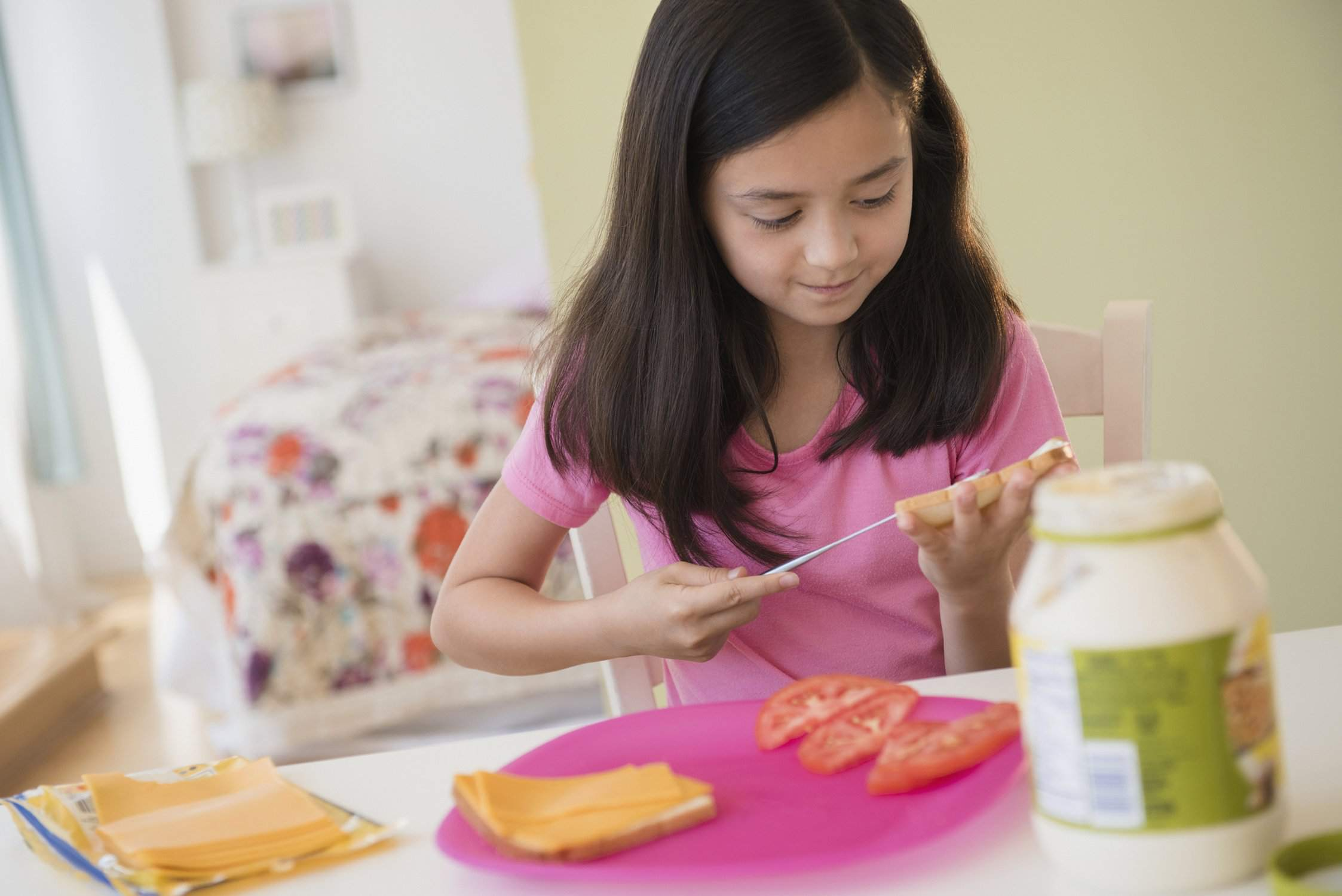 young girl making a sandwich