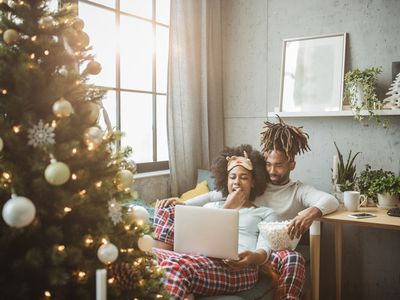 couple watching christmas movies on laptop