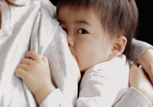 Baby boy being breastfeeding fed,close up