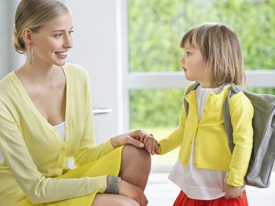 Little girl getting ready for school