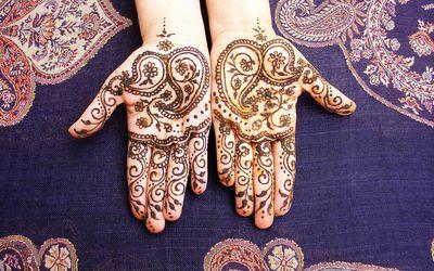 Henna tattoos on open hands