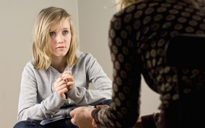 teenager talking to therapist
