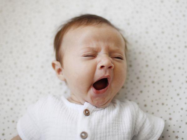 baby yawning in crib