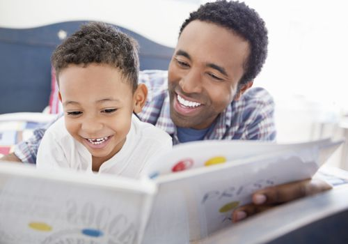 single parent reading to his young son
