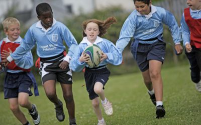 Kids playing rugby, photo by Peter Cade
