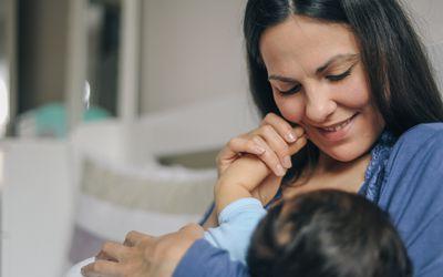 mother breastfeeding newborn baby