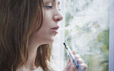 Woman with an e-cigarette