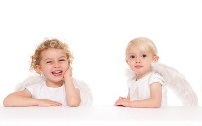 Two cherubs - stock photo