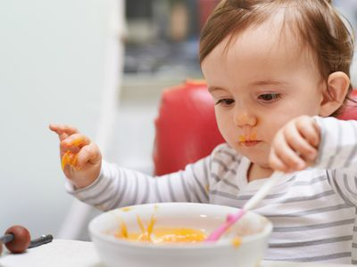 a toddler eating