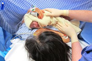 Mom Holding Baby in the OR After a Cesarean