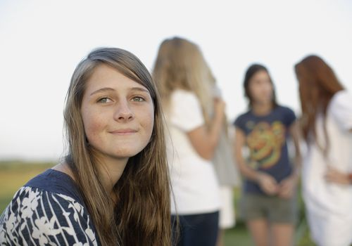peer pressure and girl sitting apart from group