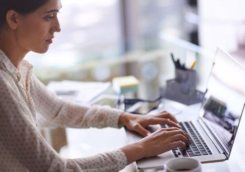 woman typing on laptop