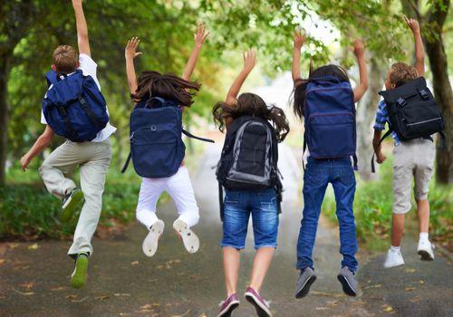 Excited kids wearing backpacks