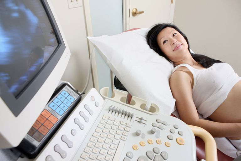 Woman getting and ultrasound in pregnancy