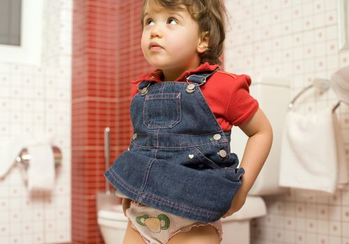 a potty-training child thinking about using the toilet
