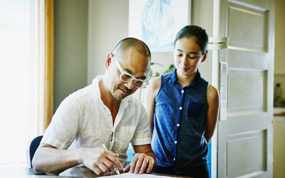 Father helping daughter with time management