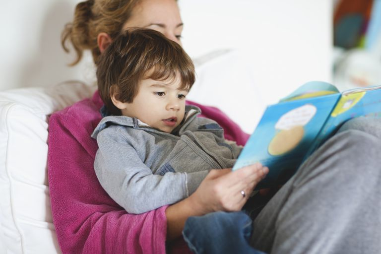 mother and boy reading book