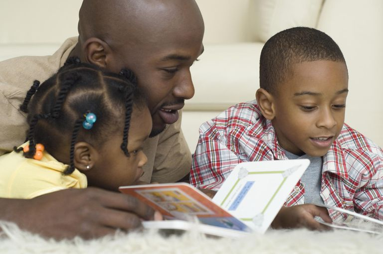 African father reading with children